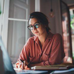 Woman at Computer via Adobe Stock