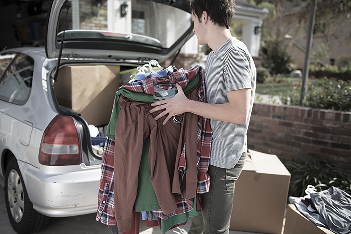 Guy Placing Clothes in car